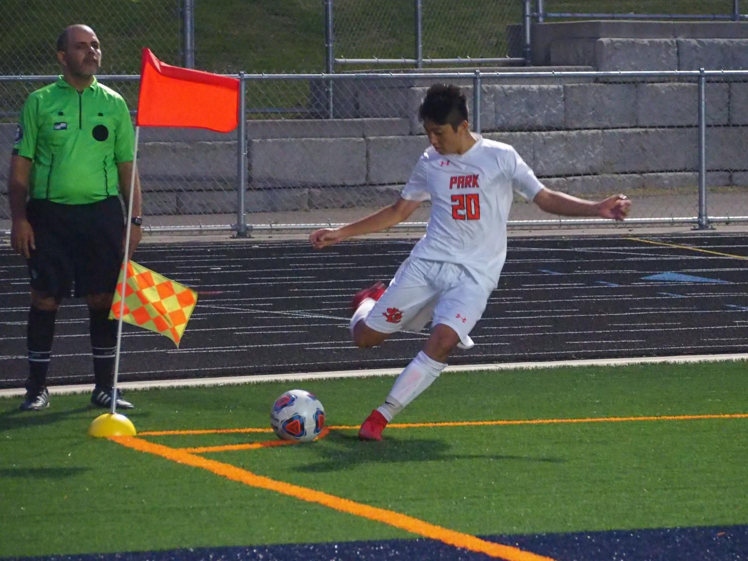 Sophomore Alex Ruiz-Shimada takes a corner kick towards goal against Robbinsdale Cooper, Sept. 13. The boys' soccer team is fifth in the state class 2A rank.