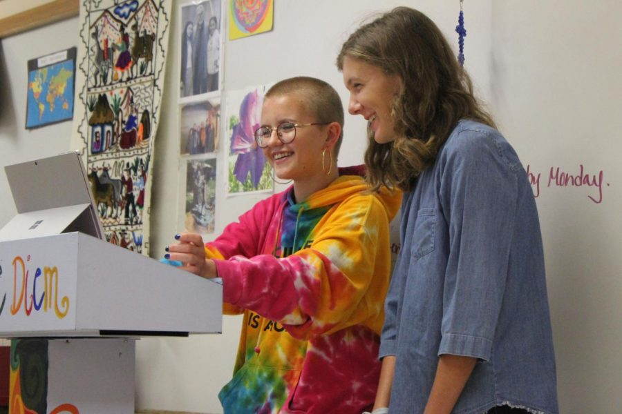 Juniors Maddie Lind and Ally Feller share what they have planned for Feminism club this year. Their first meeting took place 8 a.m. Sept. 20 in B320 classroom.