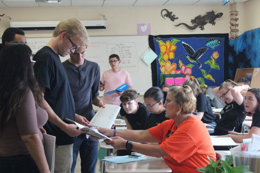 IB Spanish teacher Jane Hudacek checks senior Casey Kreie's homework during her sixth hour class Sept. 26. During this period she teaches 41 students.