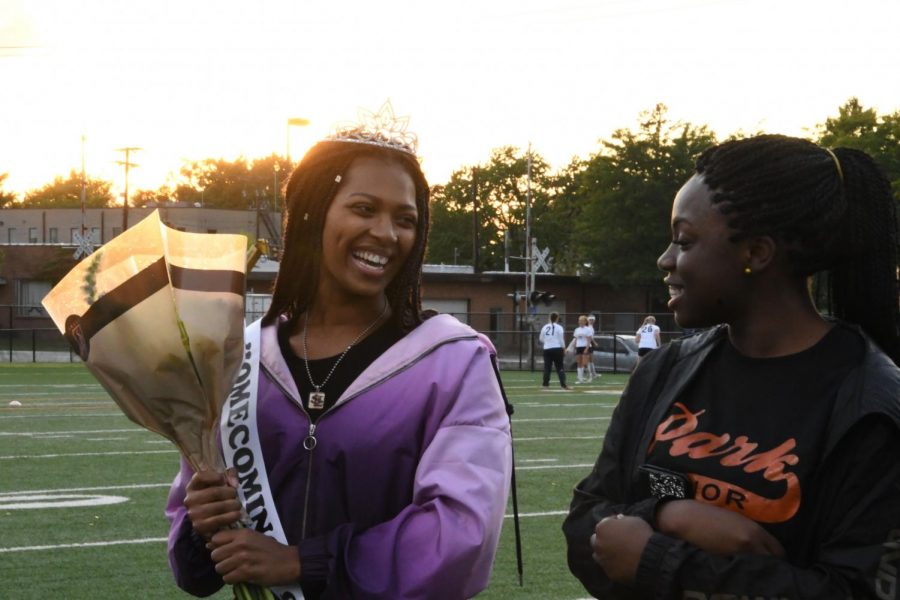 Homecoming+queen+Jada+Witherspoon+smiles+at+the+other+queen+candidates+after+she+is+crowned+queen.+Jada%27s+king+is+fellow+senior+Danny+Hunegs.+