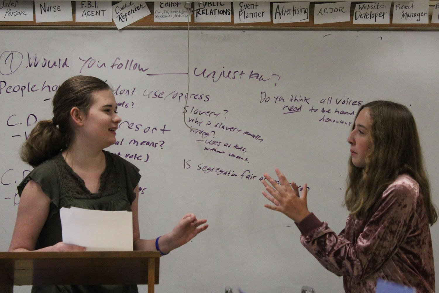 Freshmen Makenzie Lomont (left) and Samantha Rekstad work on debate skills during meeting Sept. 19. The debate team meets at 3:30 p.m. every Monday and Wednesday in room B222.