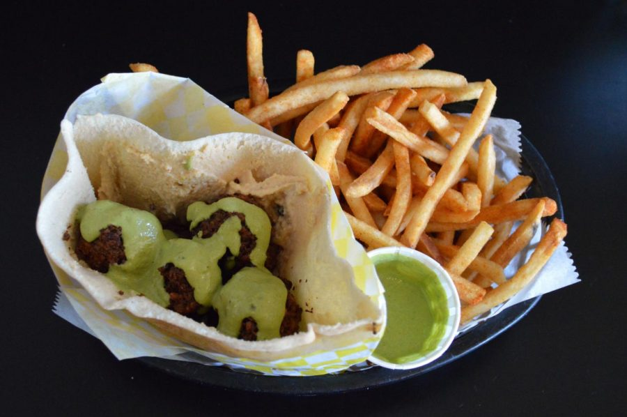 Named+Foxy+Falafel+on+the+menu%2C+this+traditional+falafel+came+with+tahini+sauce+and+french+fries.+The+falafel+sandwich+was+given+a+3%2F5+rating+for+its+interesting+spice+blend+and+tasty+tahini+sauce.