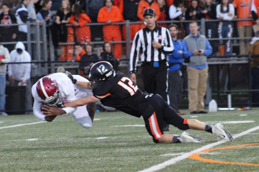 Junior Jacob Brown tackles Richfield player during the first quarter of the St. Louis Park homecoming game.