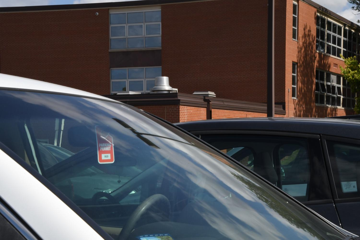 A parking pass hangs from Park students car in the student lot. Students can buy their parking passes in the student office for $50.