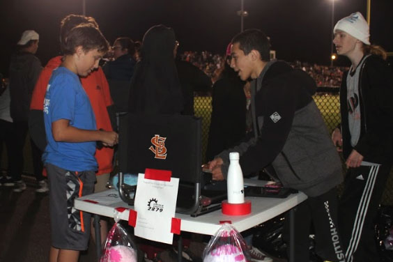 The robotics team sells cotton candy for its fundraiser at the St. Louis Park homecoming game Sept. 21.