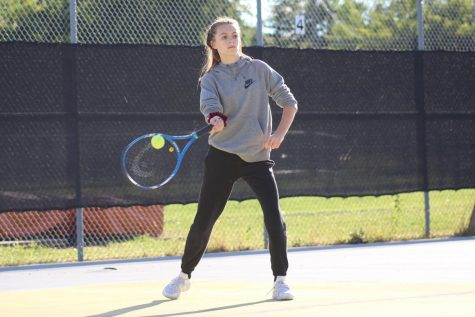 Junior Alyssa Barth hits a ball during a match against Benilde-St. Margaret's Sept. 21. According to Barth, she is not wearing her Park team uniform because of the cold weather.
