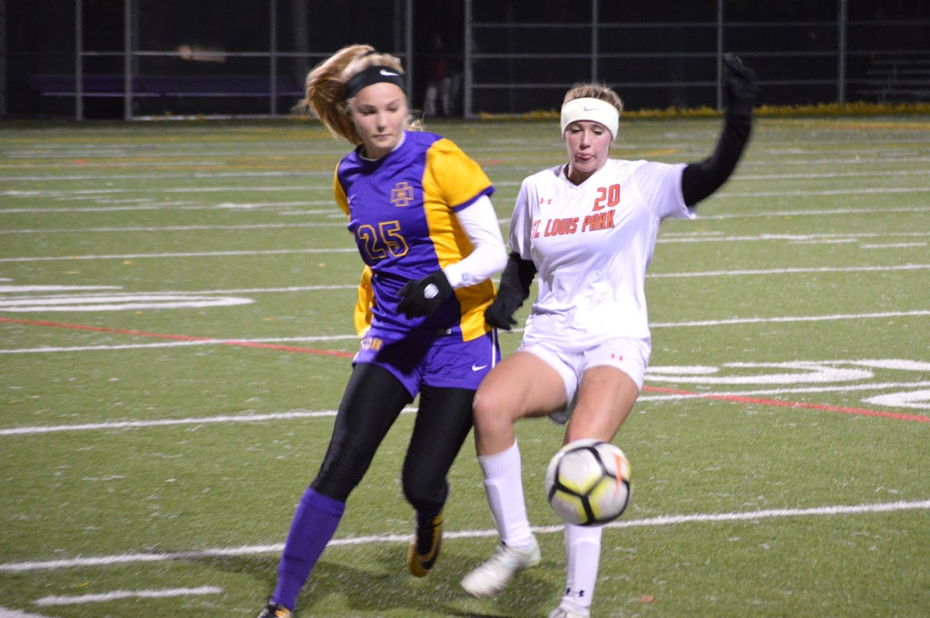Freshman Kate Kasica uses her body to keep the ball away from one of Cretin-Derham Hall's offensive starters. Park lost 0-3 Oct. 12.