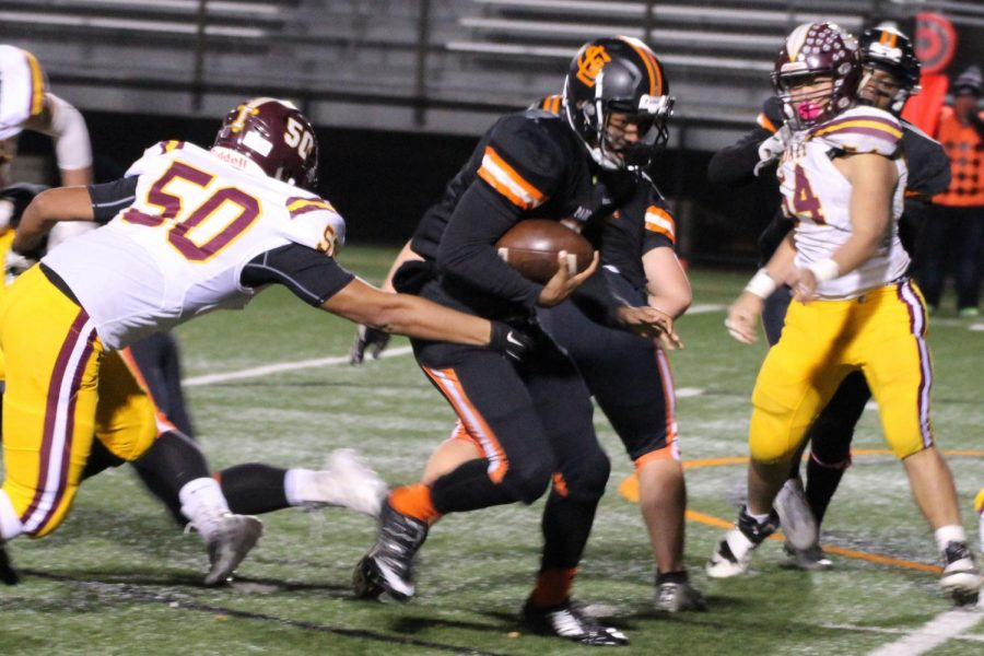 Junior Sajid Nathim avoids defender on opposing team, during the second to last home game of the season against Irondale. Their next game will take place at 7pm on Oct. 17 at the high school stadium.