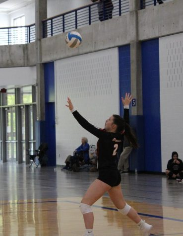 Sophomore Olivia Lainsbury serves the ball to the opposing team. The volleyball team played in the Hopkins tournament Oct.6, finishing the day with a score of 2-2.
