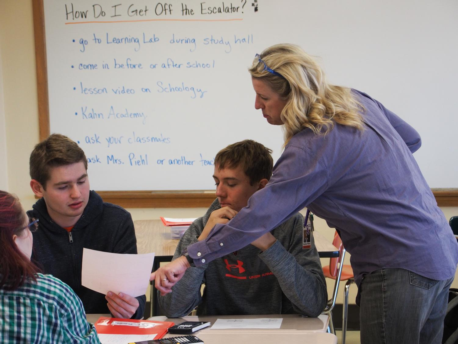 Keisha Piehl helps students in her Advanced Algebra AB class. Piehl tries to leave time at the end of each class for students to ask questions.