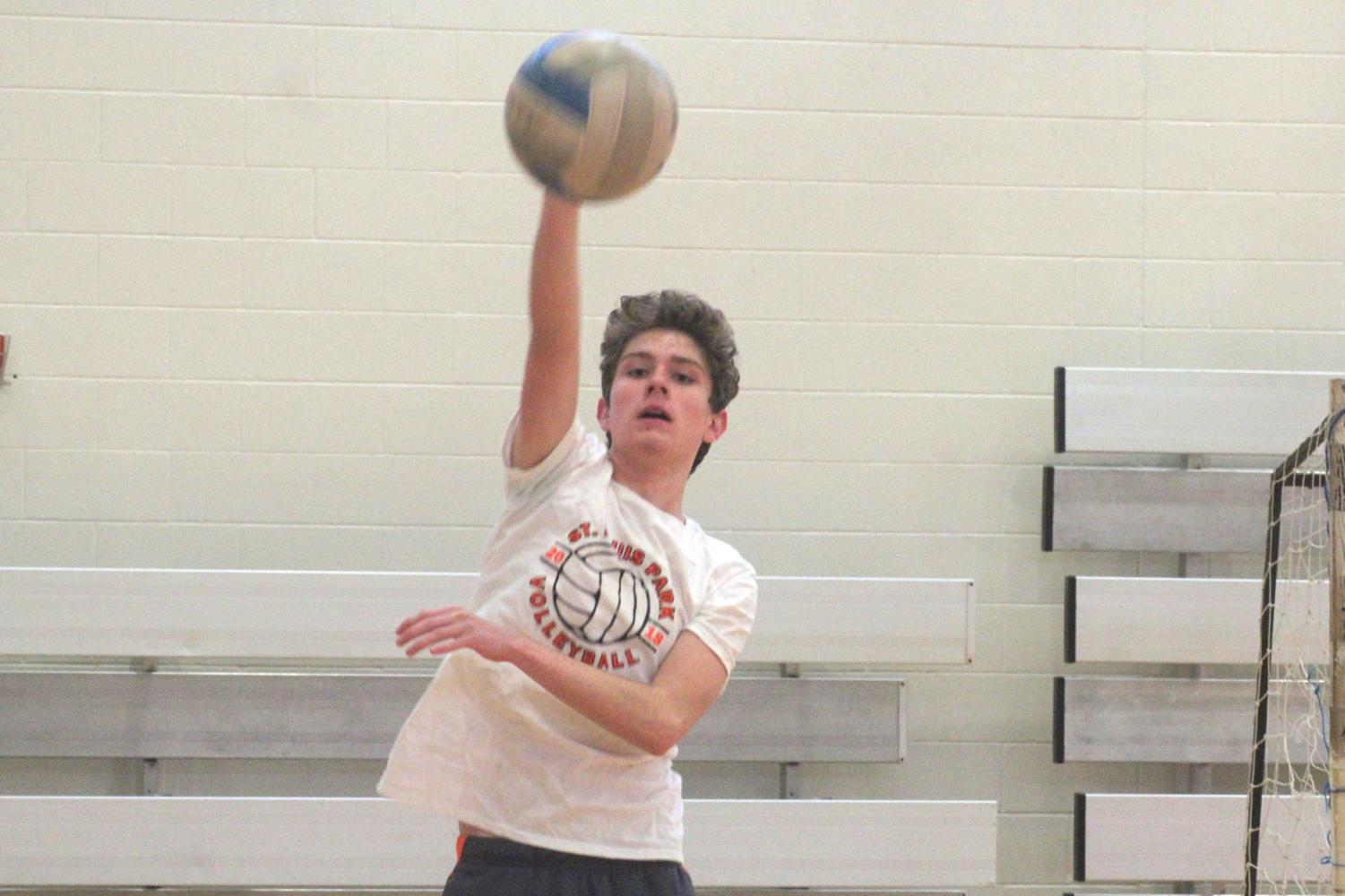Sophomore Ryan Barnett serves the ball during the junior varsity volleyball practice.