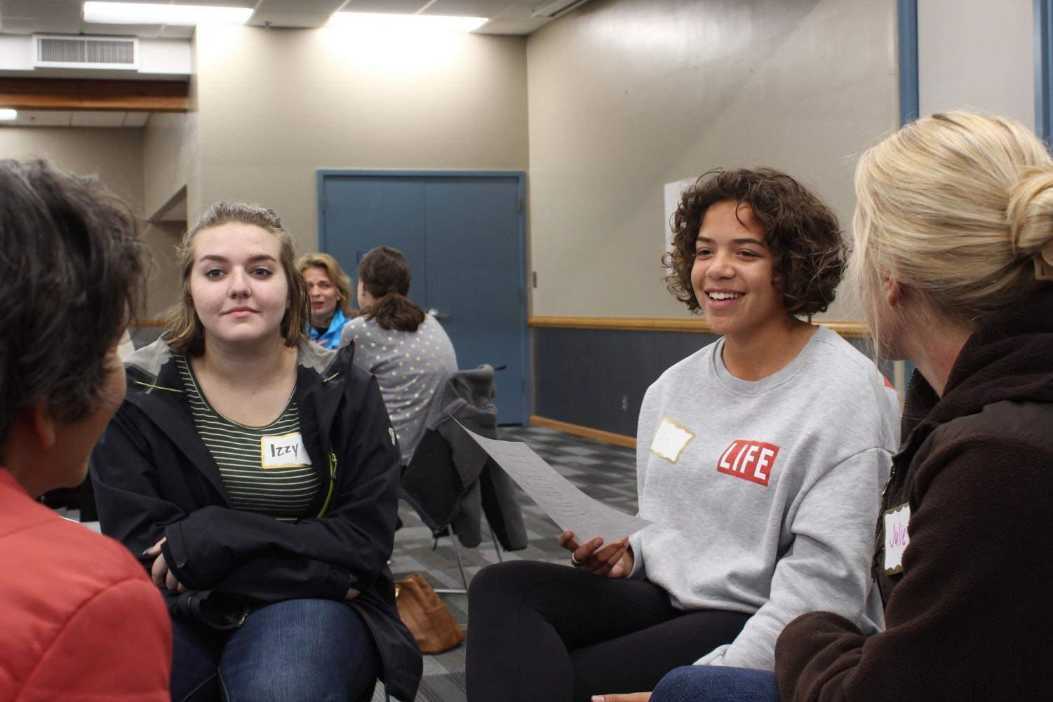 Juniors Izzy Kanne and Zoe Younger participate in a community discussion led by the Community Education Advisory Council Oct. 11 at the Rec Center. As members of SOAR, they attended this event to discuss racial issues in St. Louis Park.