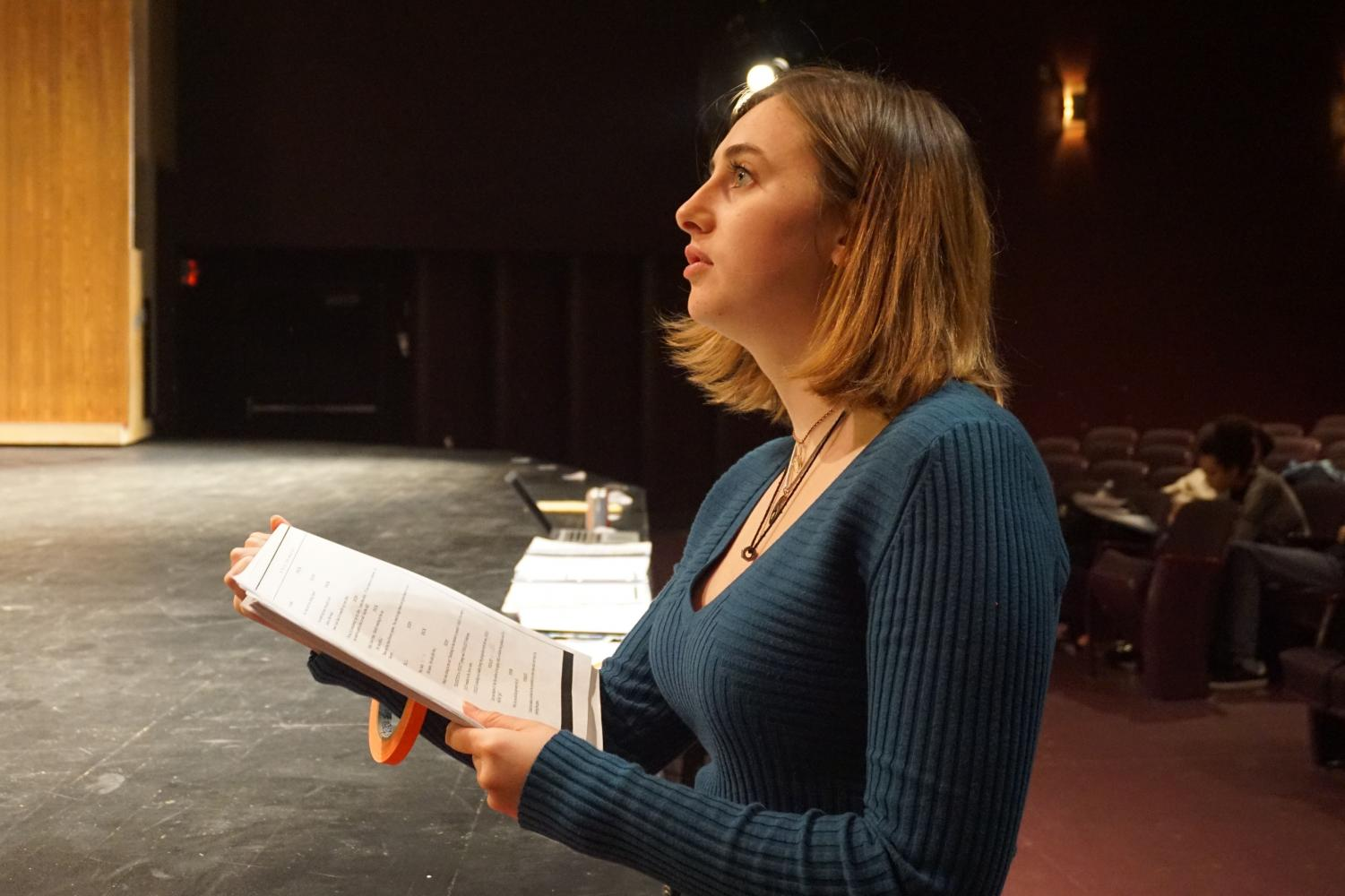 Senior Nietzsche Deuel feeds lines to actors during theater rehearsal Oct. 24. Deuel is the active stage manager for '9 to 5 the Musical.'