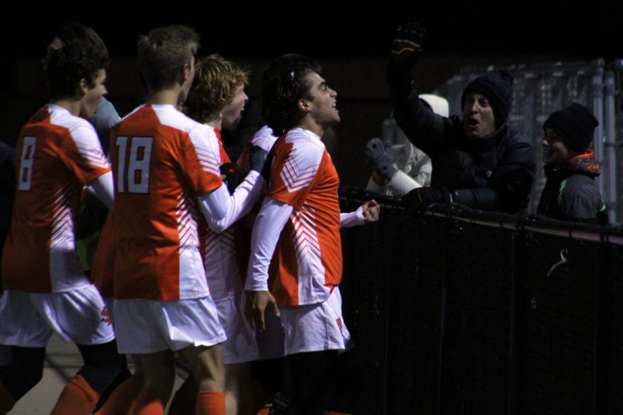 Boys's soccer team celebrates goal by junior Nick Riley in overtime. Their next section game will be Saturday, Oct. 13