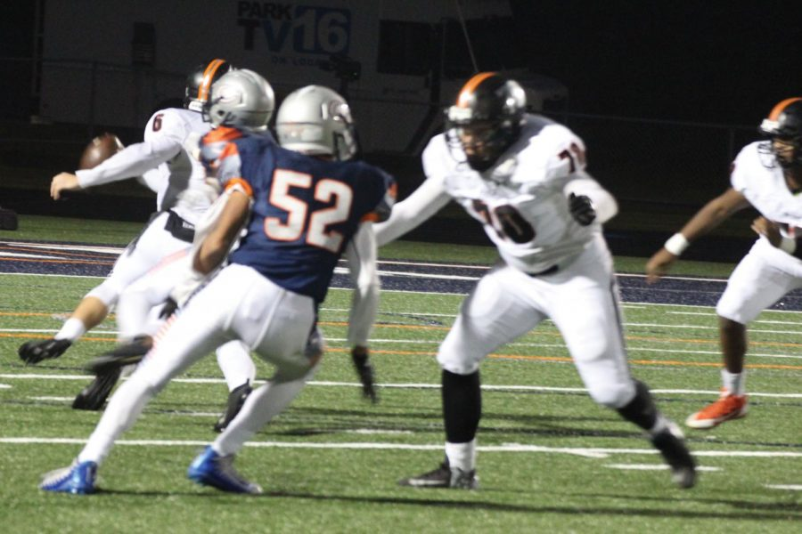 Senior Alejandro Caceres blocks apposing player in attempted tackle on the quarterback. This was Park's last game of the season against Robbinsdale Cooper Oct. 27.