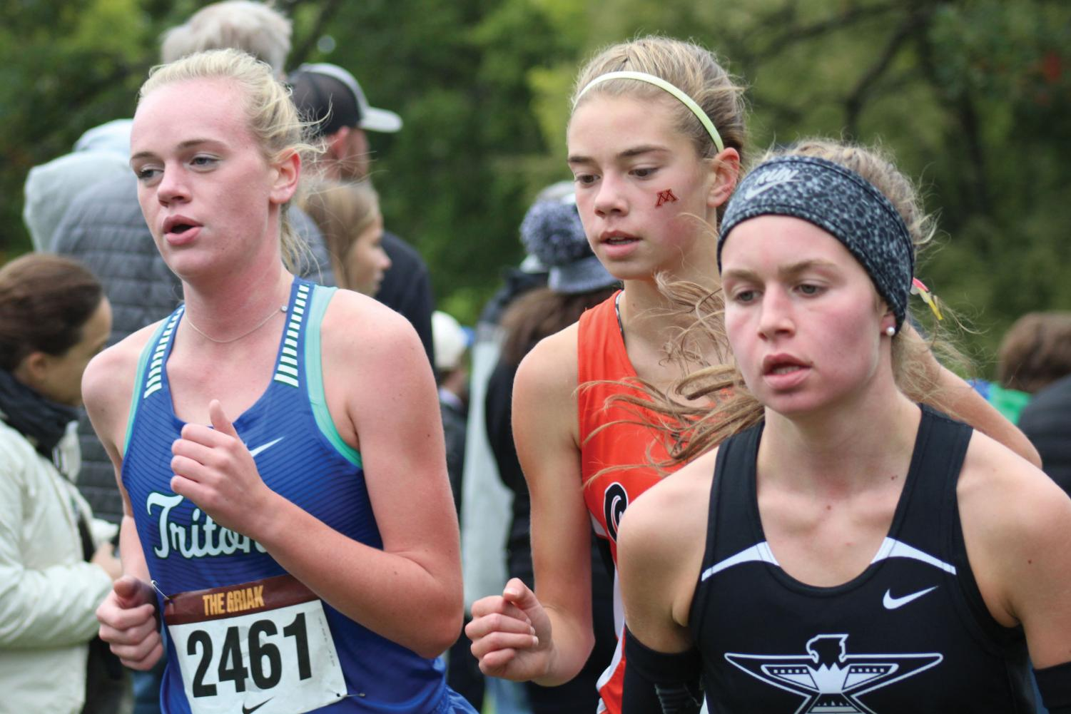 Freshman Josie Mosby attempts to push past her opponents during the Griak meet. It took place Sept.29