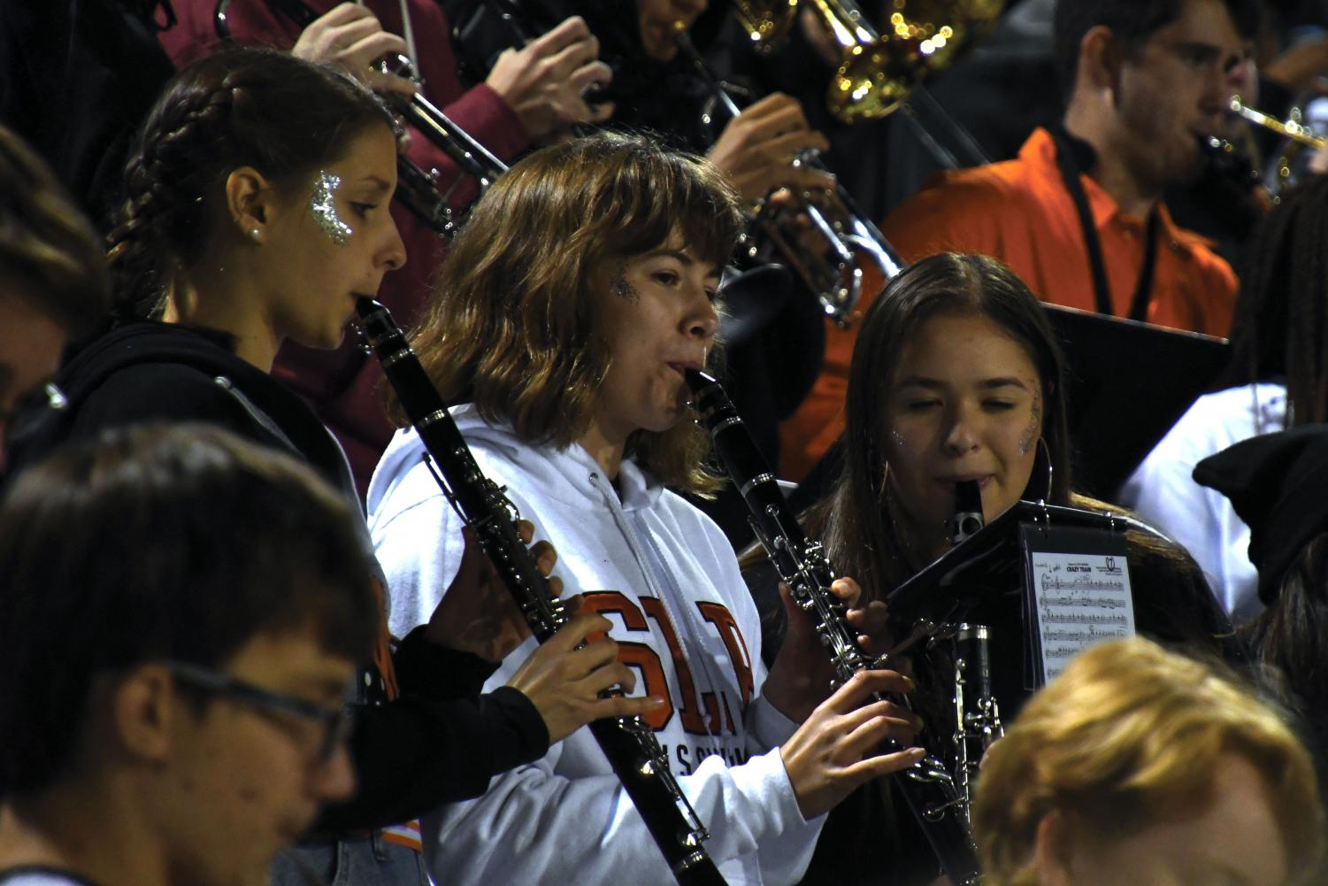 Seniors Claudia Stone, Lexi Lee and Cecilia Brown play in the pep band during Park's homecoming game Sep. 21. Lee participated alongside her peers at the Metro West All-Conference band.