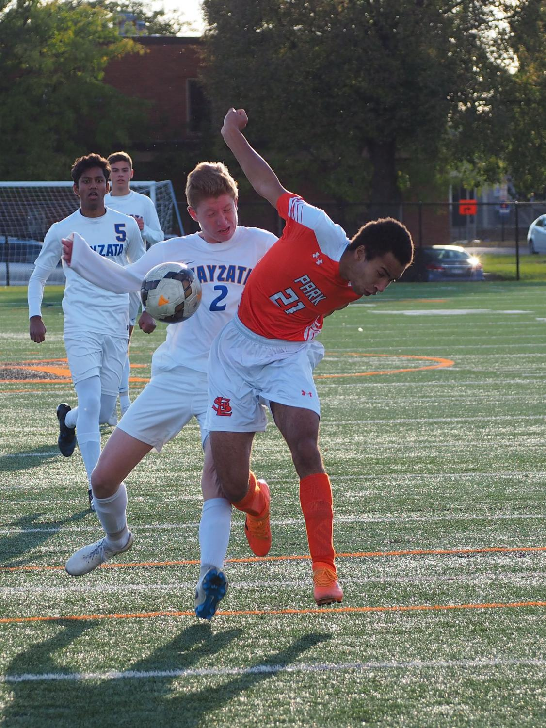 Senior+David+Benjamin+attempts+to+use+his+body+to+win+back+an+air+ball.+Benjamin+has+scored+eight+goals+through+out+the+conference+season.+
