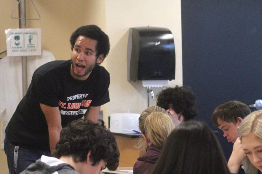 Science teacher Alexander Polk makes an announcement during his fifth hour class. He teaches tenth grade chemistry.