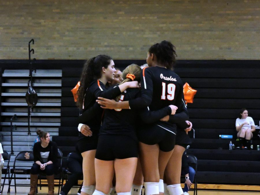Players huddle together to regroup after a play. Park won against Benilde 3-0 during the senior night match on Oct. 16. The next game will be against Rochester Century High School at 5:15 Oct. 18 at National Volleyball Center in Rochester.