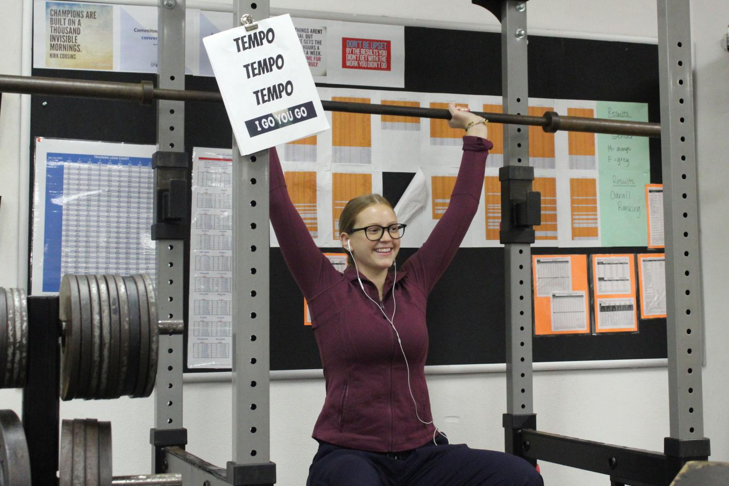 Senior Lindsey Olson works out with the weight bars. The weight room at St. Louis Park High School is a workout area for students.