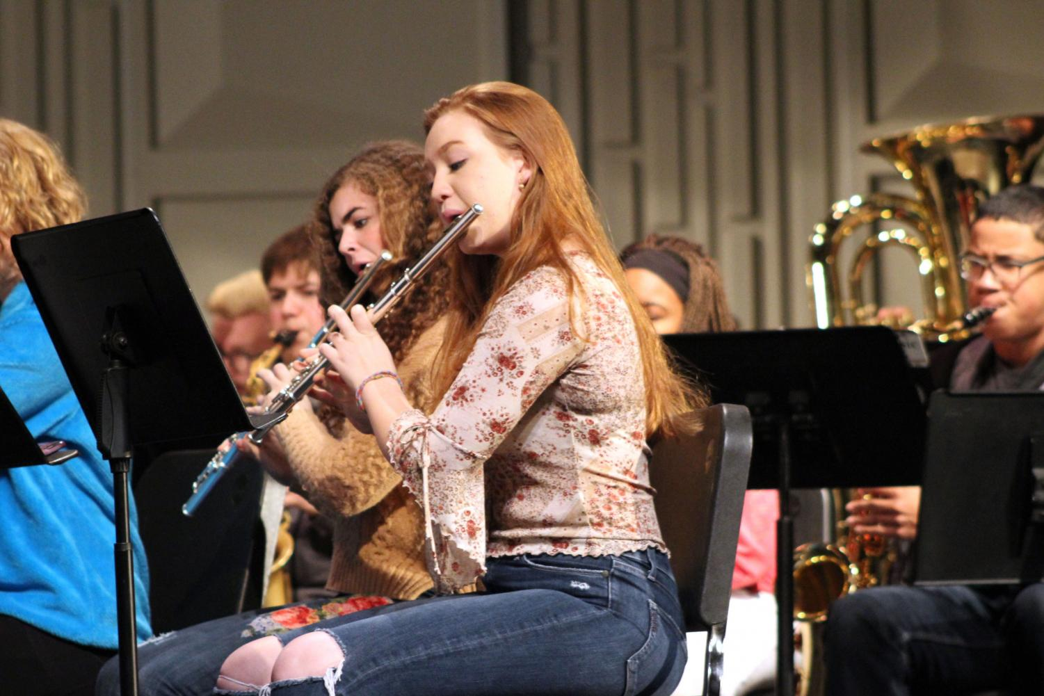 Senior Ana Armbrecht plays the flute at the joint band and Park Singers practice Nov. 28. The combined group will perform at the band concert Dec. 3.