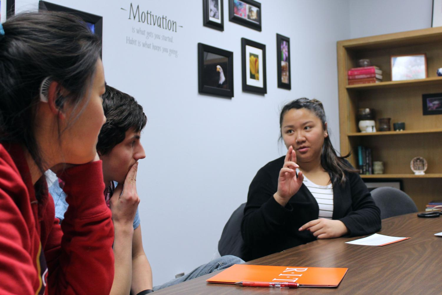 Seniors Anna Kasper and Alessandro Giannetti meet with Rochester Institute of Technology Nov. 15. RIT representative Lian Jackson speaks to the students through sign language.