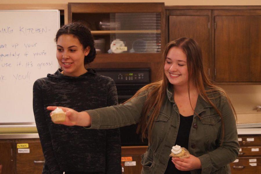 Senior Cecillia Brown hands a club member a vegan coconut cupcake. Vegan Club celebrated multiple birthdays and a new monetary grant this Wednesday on Nov. 14.
