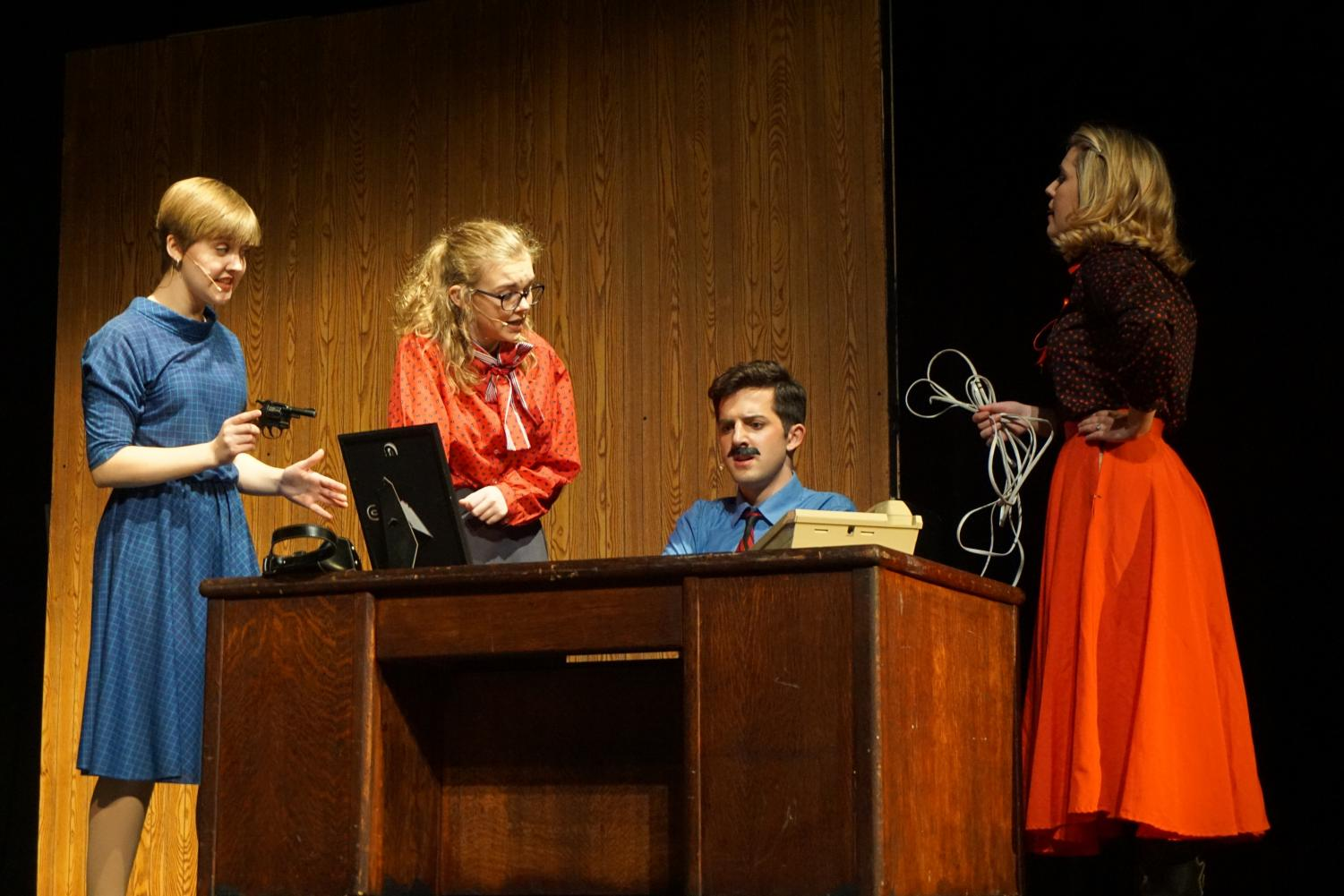 Sophomore  Phoebe McKinney, junior Isaac  Wahl and seniors Evie Nelson and Emma Yarger, perform a scene from '9 to 5 the Musical'. Opening night for the musical took place Nov. 9th with more performances to come Nov. 11, 16, 17 and 18.