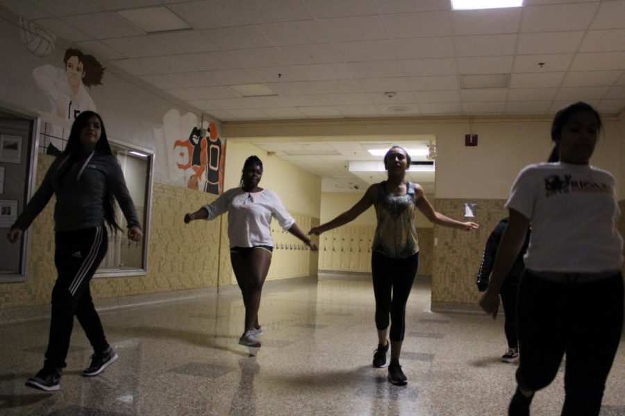 Parks new dance team practices one of their routines, choreographed by coach Tontiana Kendricks, in the Dakota Foyer after school Nov. 1. The team is rehearsing multiple different routines which they will perform at boys basketball games this winter.