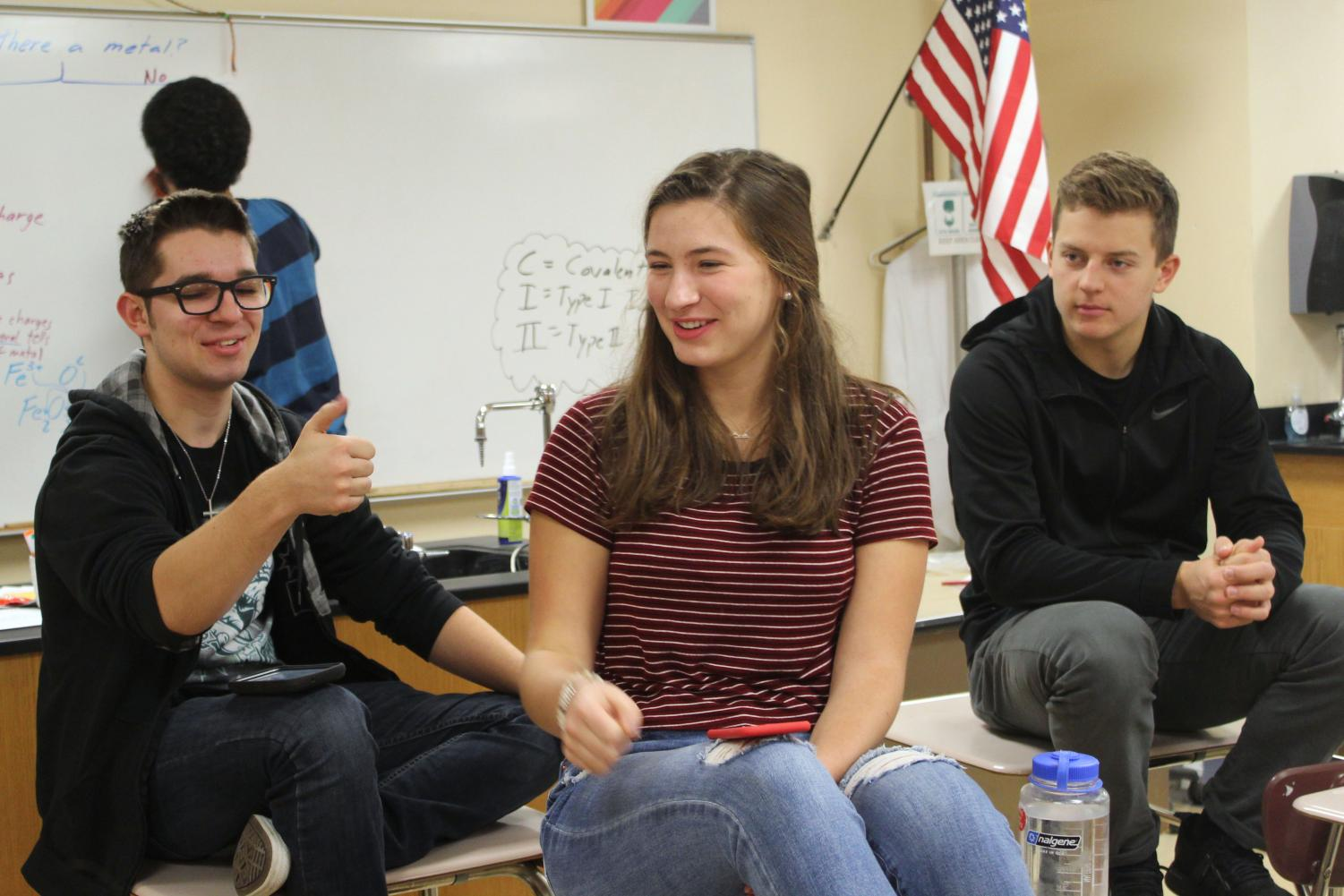 FCA leaders Aaron Ellingson and Libby Ramspurger discuss devotionals with member, sophomore Caleb Stokes at a meeting Oct. 30.