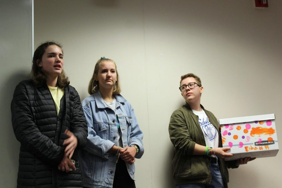 Sophomores Claire Bargman, Zoe Frank and junior Amelia Ryan share about the new recycling program being implemented to the Park staff members. A goal for the climate action plan is to reduce solid waste by 50 percent by 2030.