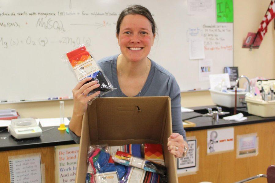 Staff member Jennifer Magdal is helping sell socks for the IB