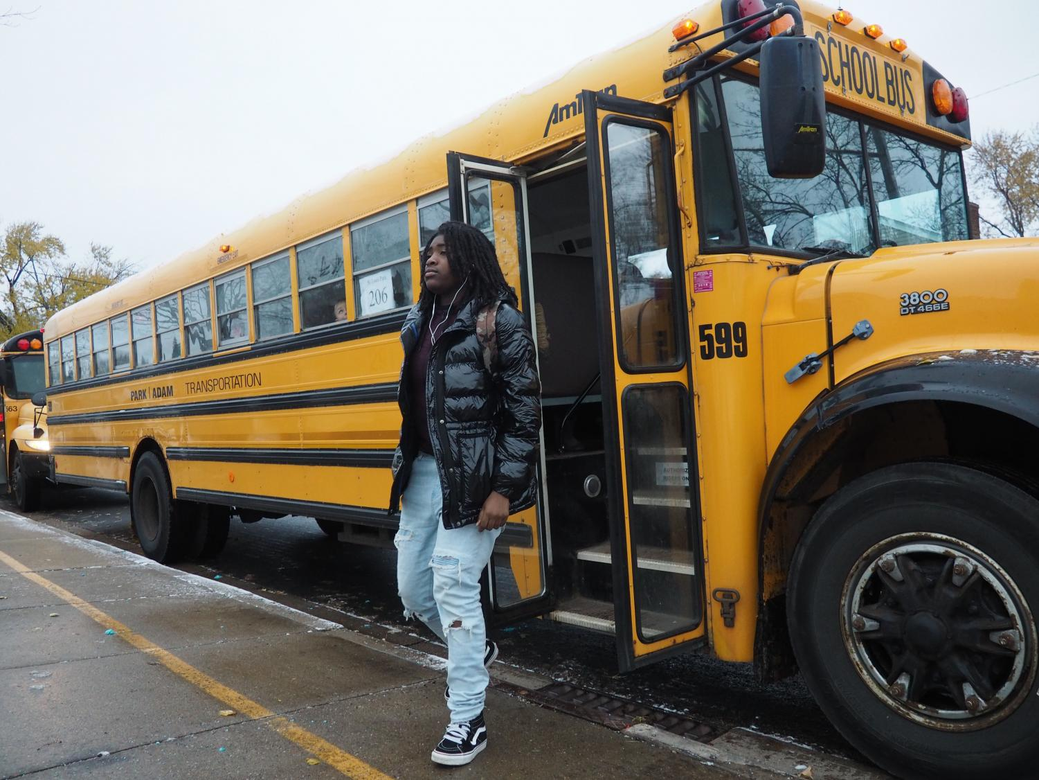 Junior Ky'areia Malone exits the bus at the High School in the morning Nov 7. The start time for the High School is 8:20 on Monday, Wednesday and Friday, and 8:40 on Tuesday and Thursday.