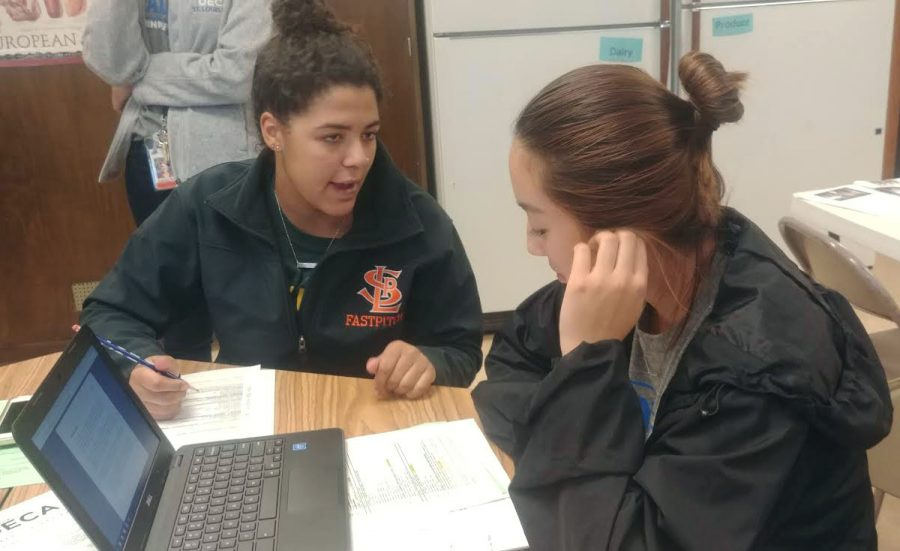 Seniors+Anya+Morrsion+and+Susanna+Hu+discuss+their+preparation+plan+for+the+upcoming+DECA+competitions.