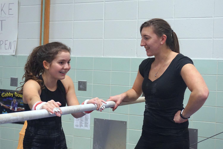 New gymnastics head coach, Dawn Thielen, talks with sophomore Rachel Stein Nov. 19. Last year Thielen was an assistant coach but got promoted to head coach for this season.