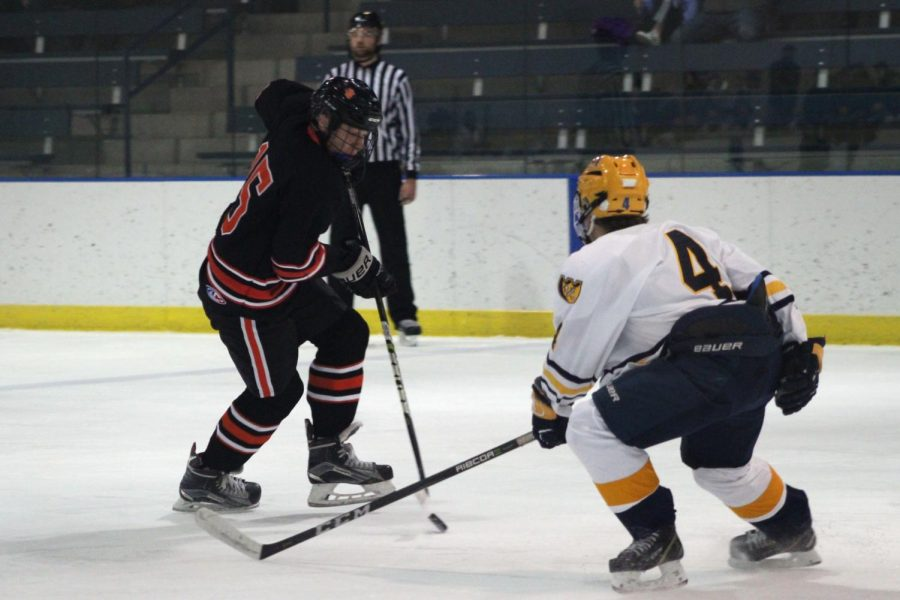 Sophomore McCabe Dvorak attempting to pass to a fellow team member. St. Louis Park's Boys' Hockey team played their first game of the season against Breck on Tuesday Dec. 27. The final score of the game was 5-1.