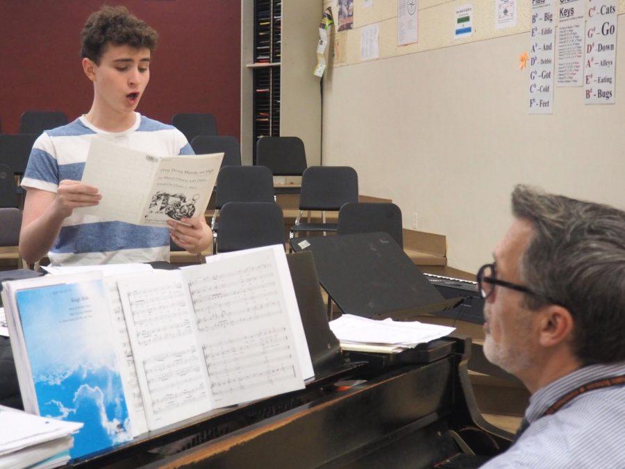Sophmore+Leo+Dworsky+practices+one+on+one+with+his+choir+teacher+Mr.+Myszkowski.+