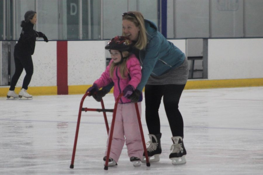 A mother teaches her daughter how to skate during open skate time at the Rec Center Nov. 17. The Turkeys on Ice event will take place Nov. 21.