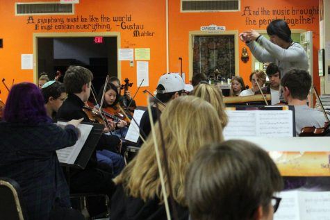 New orchestra conductor Kou Lee conducts third hour class.