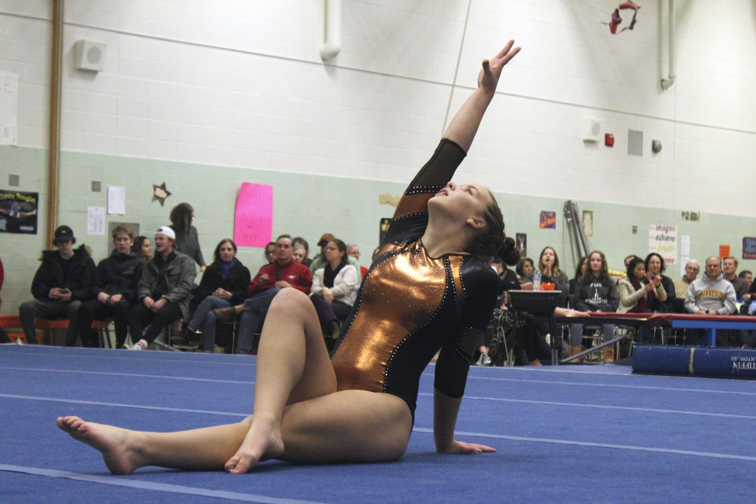Sophomore Marissa Beottcher poses at the end of her floor routine.  St. Louis Park gymnastics took on Richfield at 7 p.m Tuesday Dec. 11 at Central Community Center.