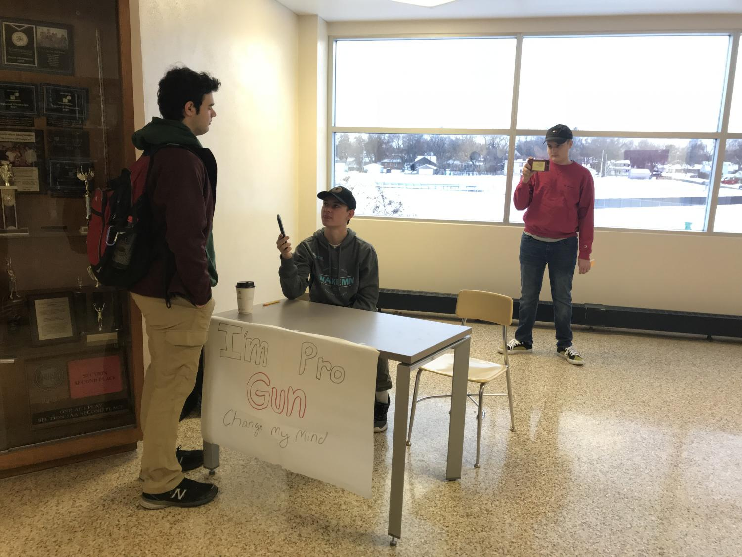 Junior Will Schwietering engages in a conversation with a Park student who happened to pass by his booth in the halls. The interaction was recorded by Schwietering's peer  Bryce Bonine for their IB English SL class.
