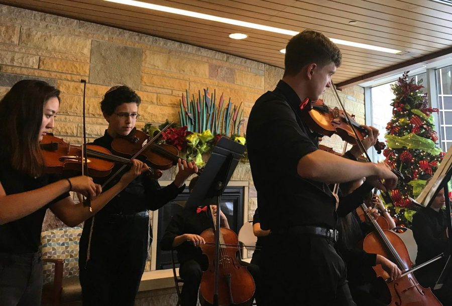 The first violins in the St. Louis Park Chamber Orchestra perform at Methodist Hospital for the second time on Dec. 6. The Chamber Orchestra performs each year at places around St. Louis Park in an effort to give back to their community.