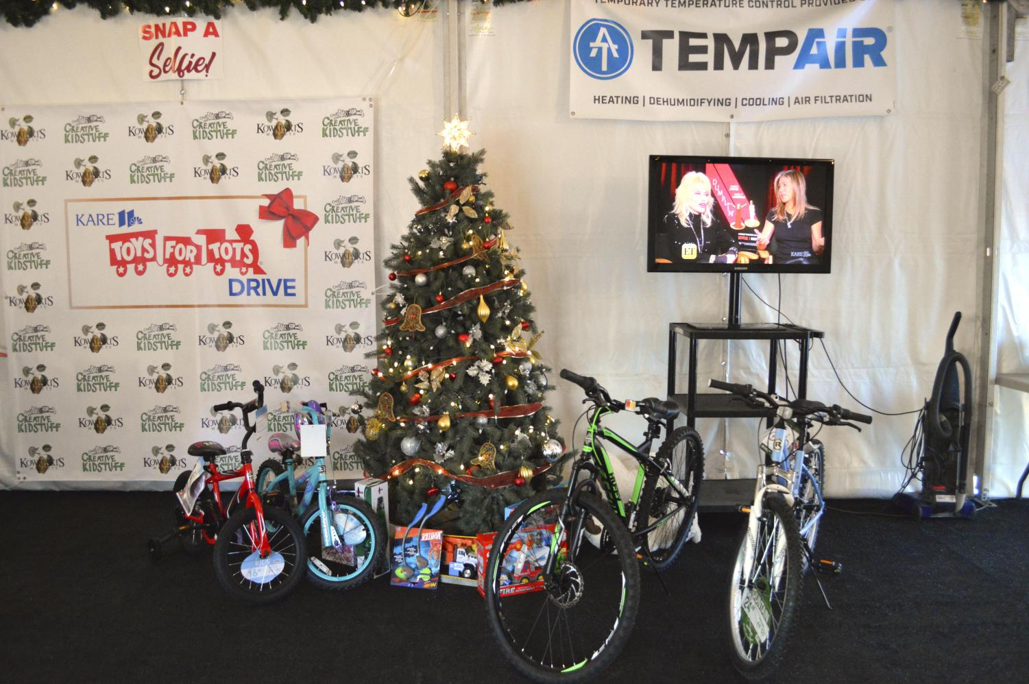 Toys sit underneath a tree at Kare 11 ready to be delivered to children in need.