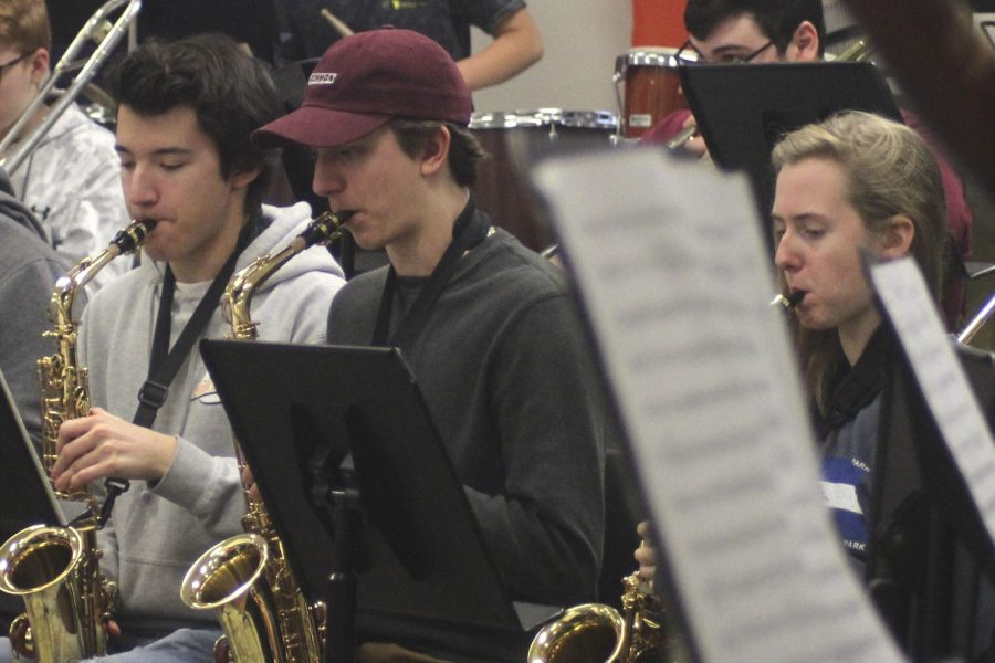 Juniors Tristan Rooney, Nathan Schemp and senior Natalie Aune practice saxophone. The band practices everyday for concerts and events.
