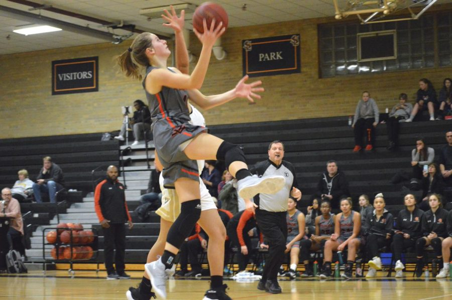 Sophomore+Faith+Johnson+leaps+to+the+basket+attempting+to+make+a+layup.+Johnson+scored+6+points+against+Fridley.