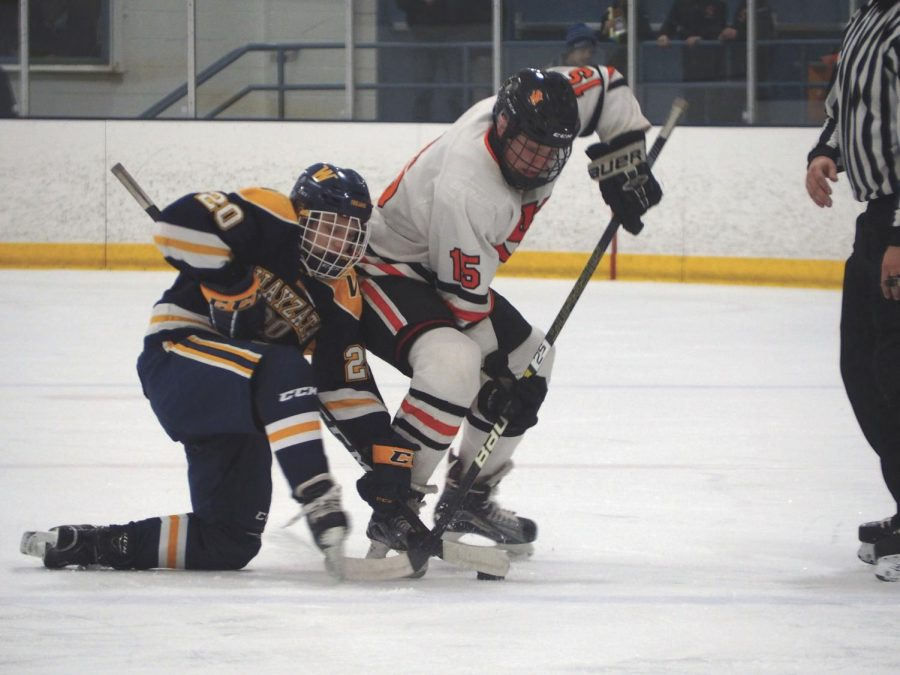 Sophomore+McCabe+Dvorak+uses+his+body+to+block+Wayzata+player+from+getting+possesion+of+the+puck.+Park+played+Wayzata%2C+losing+0-10+Dec.+13.+The+team%E2%80%99s+next+game+is+7+p.m.+Dec.+21+at+the+Rec+Center.+