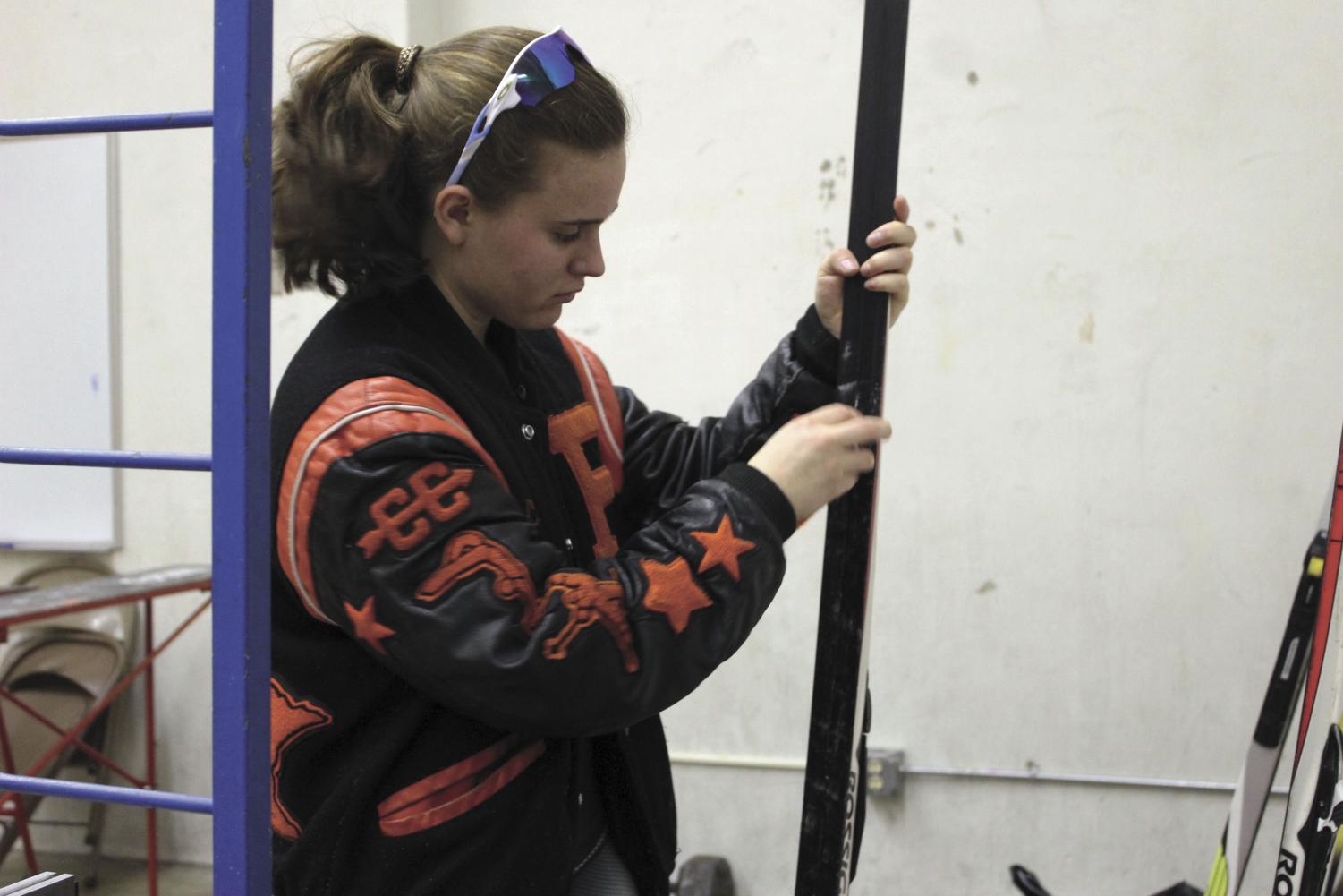 Senior Cece Schmelzle waxes her skis in preparation for her next qualifying meet. The race was on the weekend of Dec. 15-16.