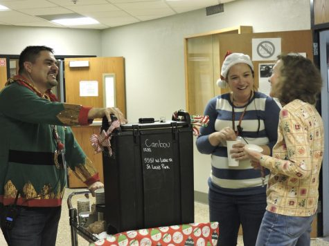 Assistant Principals Jessica Busse and Todd Goggleye deliver beverages and treats to all of the high school staff Dec. 21, around the high school. They also handed out