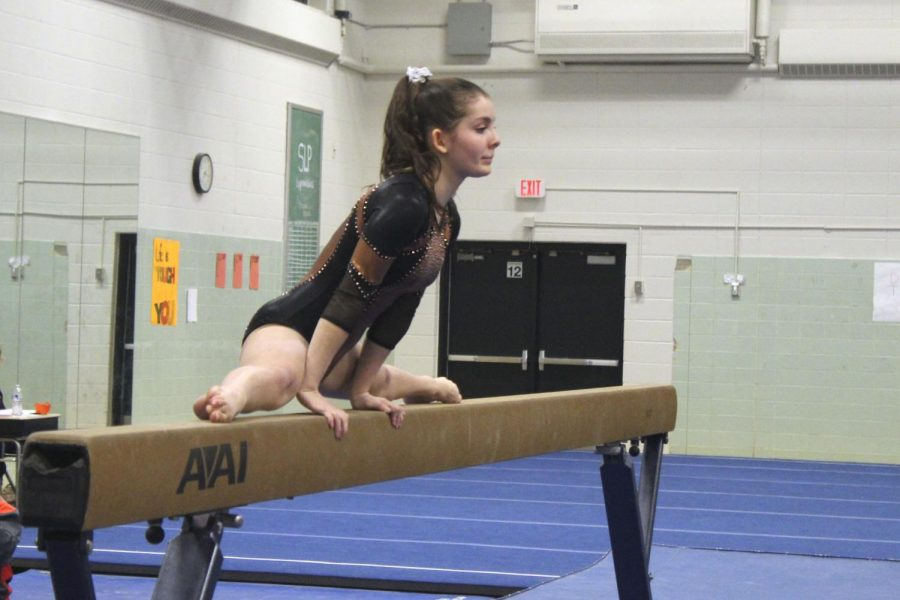 Sophomore+Rachel+Stein+begins+her+routine+on+the+beam+Dec.+11+at+their+home+meet+against+Richfield.+The+Park+Gymnastics%27+team+has+begun+strength+training+once+a+week+to+help+them+develop+their+skills+in+preparation+for+future+meets.+